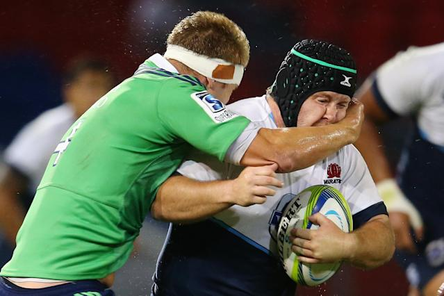 NEWCASTLE, AUSTRALIA - FEBRUARY 14: Benn Robinson of the Waratahs is tackled by Gareth Evans of the Highlanders during the Super Rugby trial match between the Waratahs and the Highlanders at Hunter Stadium on February 14, 2014 in Newcastle, Australia. (Photo by Mark Kolbe/Getty Images)