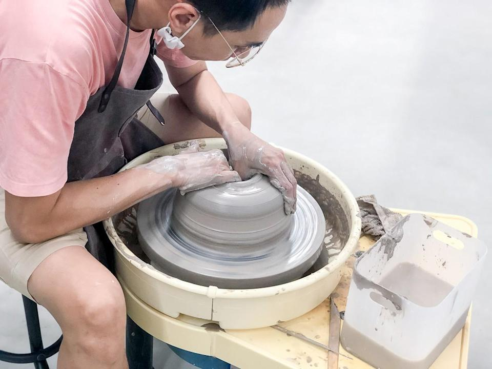 Picture of a man doing pottery work during the pottery craft workshop