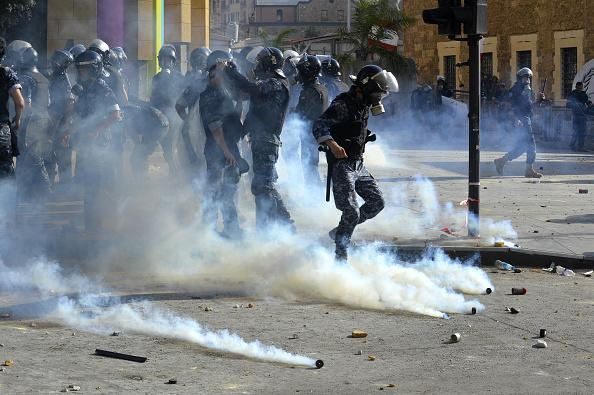Demonstrators clash with Lebanese riot police as riot police intervene them with tear gas canisters during a protest against government at the Martyrs' Square after the deadly explosion at the Port of Beirut led to massive blasts on 4th August in Beirut, Lebanon.