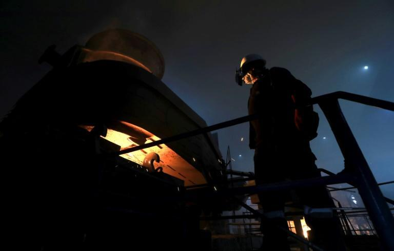 An Iraqi worker operates a furnace for steelmaking at Hend steel company in Arbil