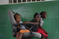 Younaika Ylet, center, plays with other girls at the Immaculate Conception Hospital, also known as the General Hospital of Les Cayes, Haiti, Monday, Aug. 23, 2021, where her mother is being treated one week after the 7.2 magnitude earthquake. The 5-year-old, who was not injured, shares her mother's hospital bed, and they have no home to return to, after the quake brought down their house in Camp-Perrin, killed Younaika's grandfather and two other relatives and seriously injured her uncle. (AP Photo/Matias Delacroix)