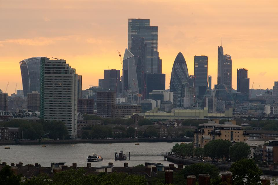 The London skyline at sunset as seen from Greenwich Park, showing skyscrapers in the City financial district