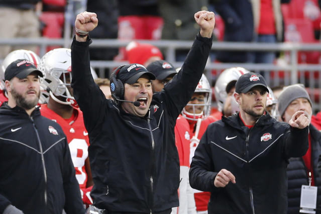 FILE - In this Nov. 23, 2019, file photo, Ohio State head coach Ryan Day celebrates on the sideline against Penn State during an NCAA college football game, in Columbus, Ohio. Heading into this years slate of conference title games a case could be made that No. 1 LSU (No. 2 CFP), No. 2 Ohio State (No. 1 CFP) and No. 3 Clemson (No. 3 CFP) have all done enough already to lose their conference championship games and still get in the College Football Playoff.(AP Photo/Jay LaPrete, File)