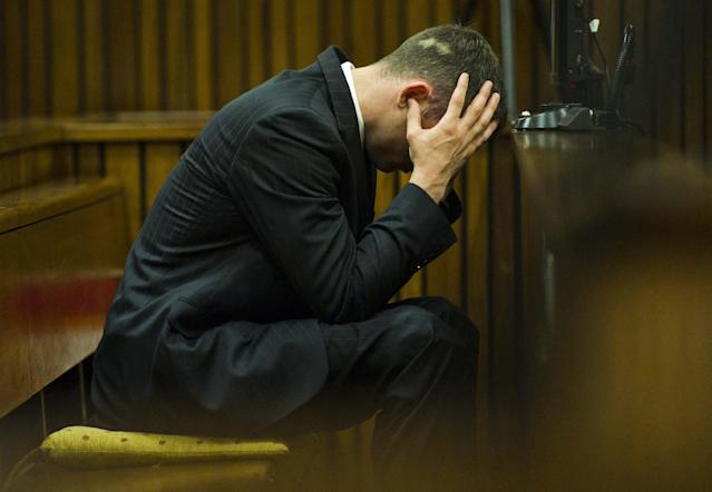 Oscar Pistorius cradles his head in his hands as he listens to forensic evidence being given in court in Pretoria, South Africa, Thursday, April 17, 2014. Pistorius is charged with the murder of his girlfriend, Reeva Steenkamp, on Valentines Day in 2013. (AP Photo/Alet Pretorius, Pool)