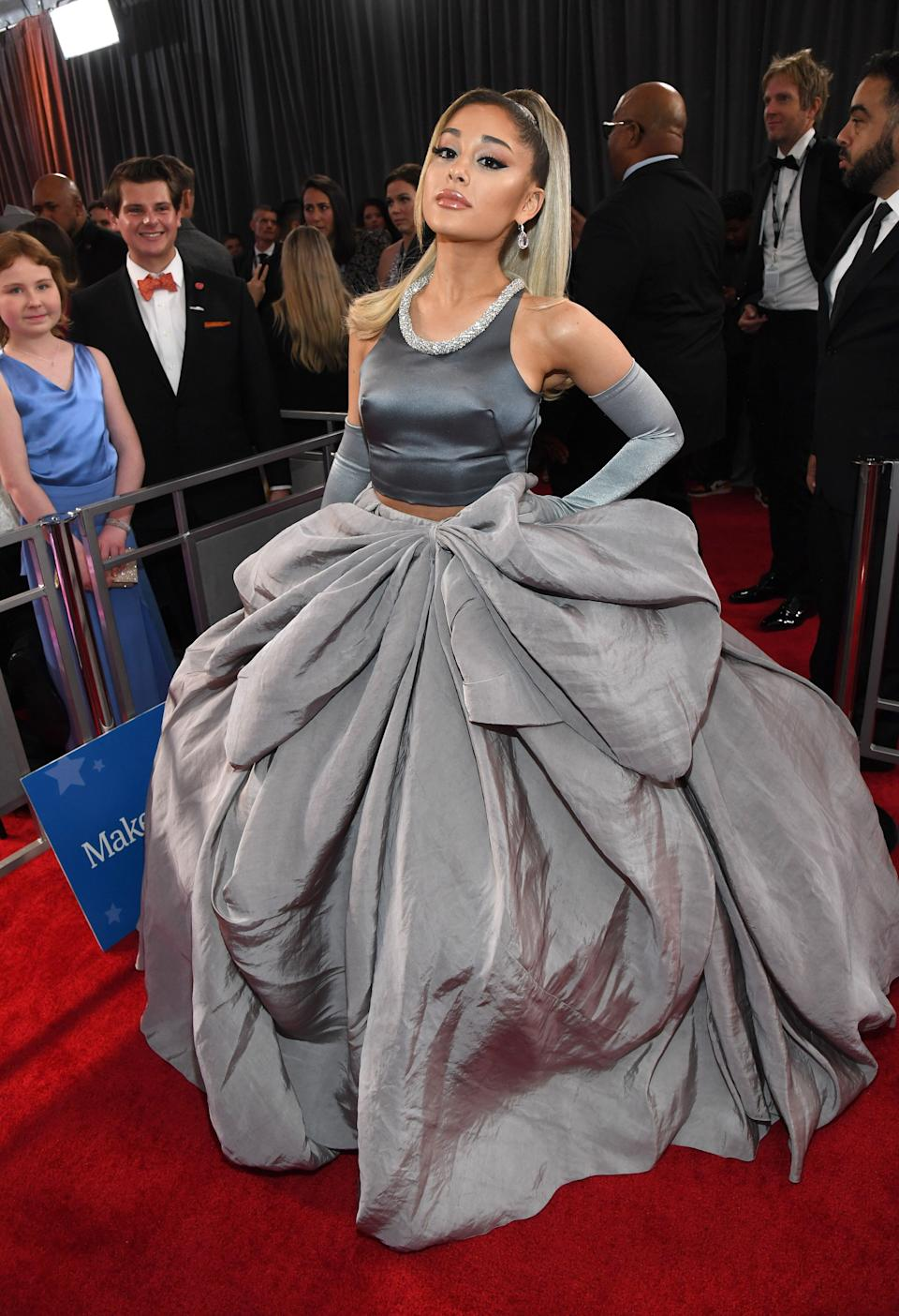 We couldn't tell you why, but Ariana Grande changed into a second, gigantic gray dress and walked the red carpet ... again.