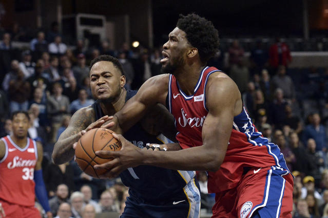 Philadelphia 76ers center Joel Embiid, right, drives against Memphis Grizzlies forward Jarell Martin in the second half of an NBA basketball game Monday, Jan. 22, 2018, in Memphis, Tenn. (AP Photo/Brandon Dill)
