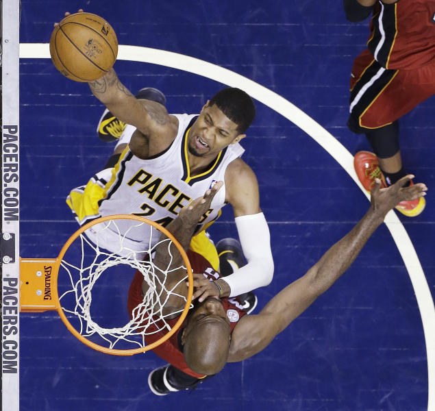 Indiana Pacers forward Paul George (24) goes up for a shot against Miami Heat center Joel Anthony during the second half of Game 6 of the NBA Eastern Conference basketball finals in Indianapolis, Saturday, June 1, 2013. (AP Photo/Michael Conroy)