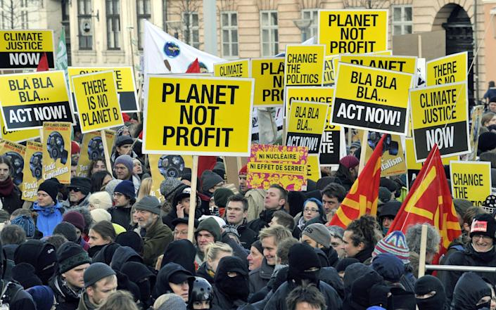Some of the 30,000 people demonstrating in the center of Copenhagen during a major UN summit on climate change, December 12, 2009 (AFP Photo/Attila Kisbenedek)