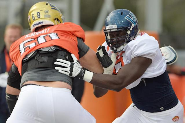 Jan 26, 2017; Mobile, AL, USA; South squad offensive tackle Conor McDermott of UCLA (68) battles defensive end Tanoh Kpassagnon of Villanova (92) during Senior Bowl practice at Ladd-Peebles Stadium. Mandatory Credit: Glenn Andrews-USA TODAY Sports