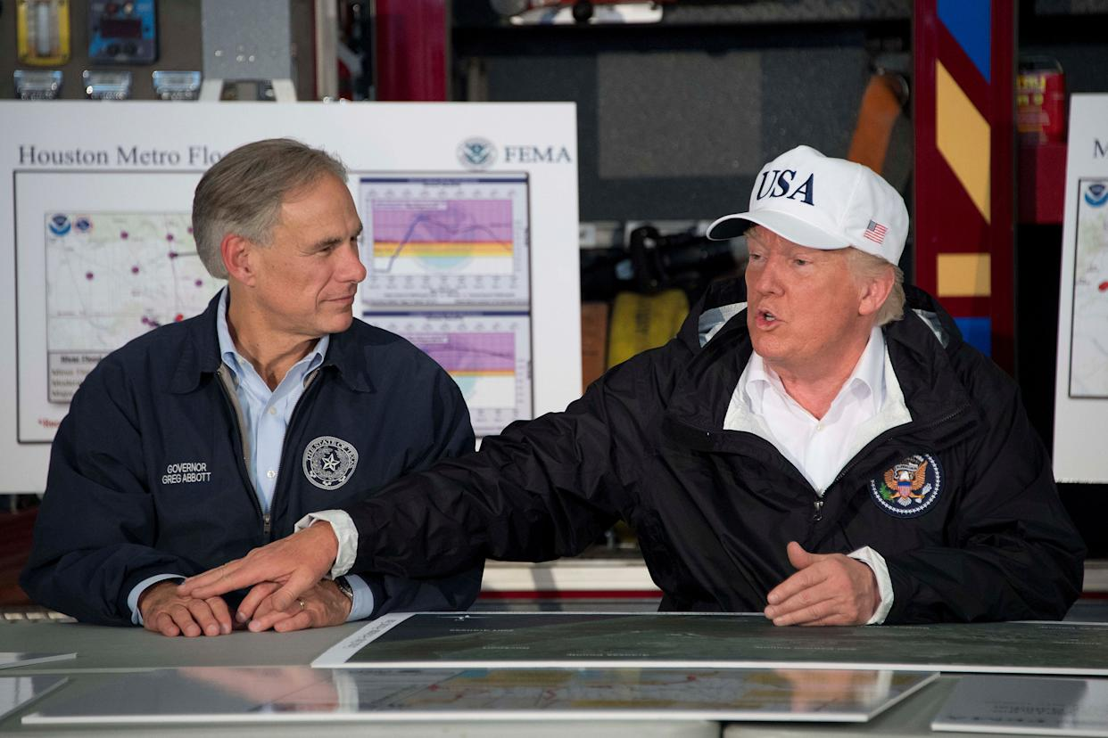 Trump sits with Abbott during a briefing on Hurricane Harvey in Corpus Christi.