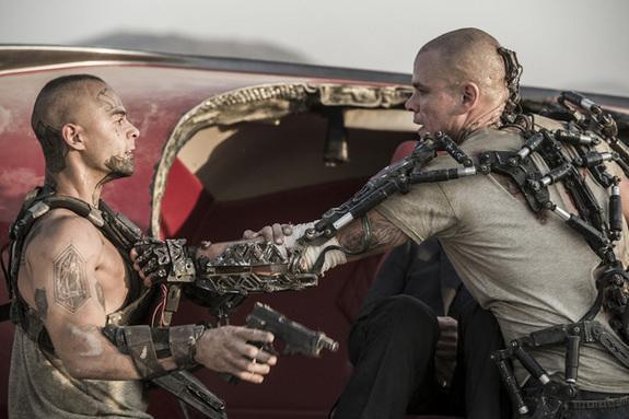 """Matt Damon (right) and Jose Pablo Cantillo face off in Columbia Pictures' """"Elysium,"""" opening August 9, 2013."""