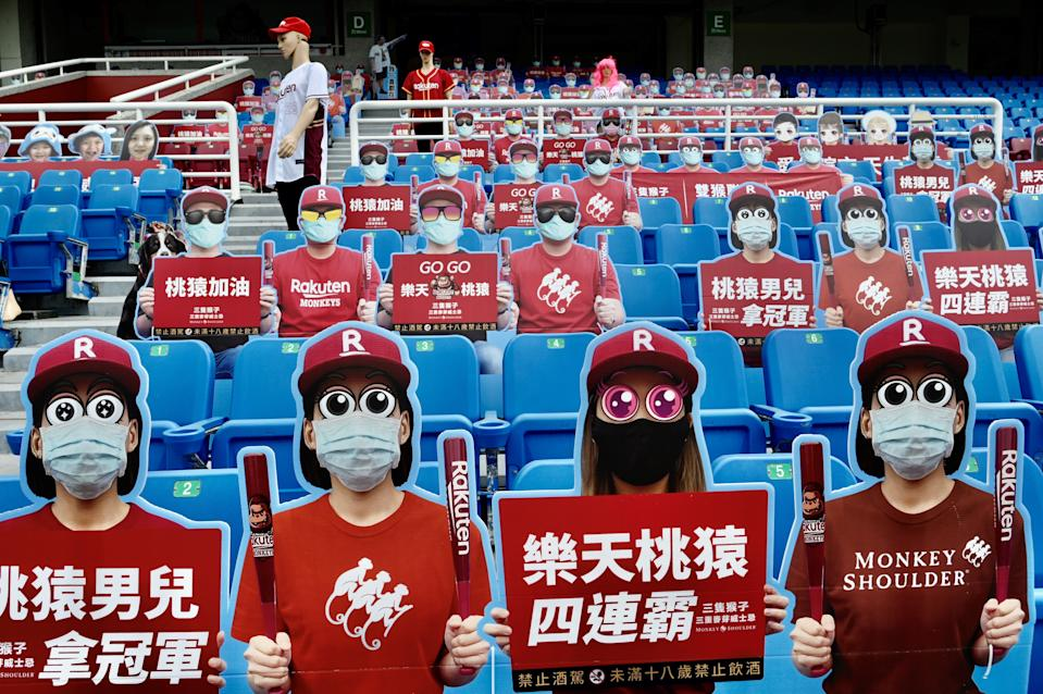 Life-size cutouts depicting a crowd of spectators are seen placed in empty seating during a Chinese Professional Baseball League (CPBL) game. (Photo by SAM YEH/AFP via Getty Images)