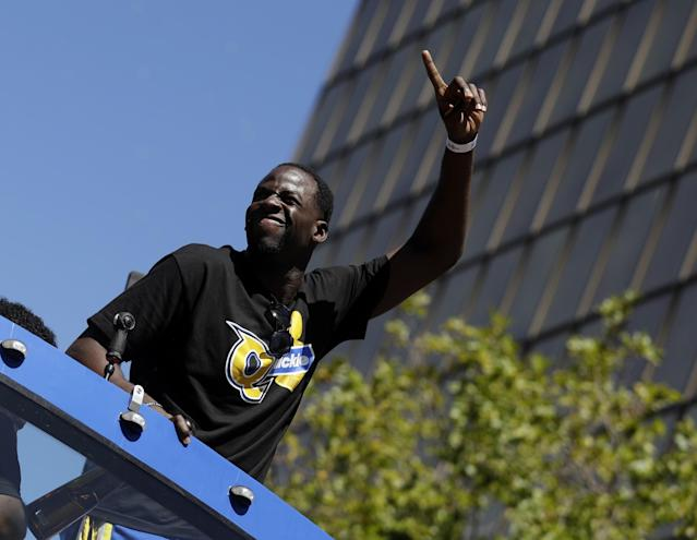<p>Golden State Warriors' Draymond Green waves at fans during a parade and rally in honor of the Warriors, Thursday, June 15, 2017, in Oakland, Calif., to celebrate the team's NBA basketball championship. (AP Photo/Marcio Jose Sanchez) </p>