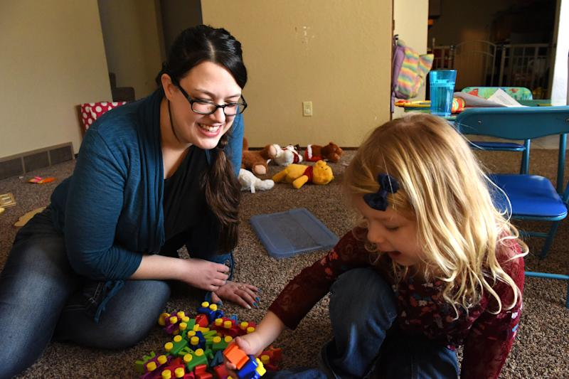 Krystal Trull plays with daughter Nikole Trull, 4, at their house in Sioux Falls, S.D.