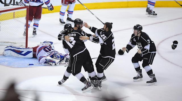 10ThingstoSeeSports - Members of the Los Angeles Kings, right, celebrate as they win in double overtime as New York Rangers goalie Henrik Lundqvist, left, of Sweden, reacts during the first overtime period in Game 5 of an NHL hockey Stanley Cup finals, Friday, June 13, 2014, in Los Angeles. (AP Photo/Mark J. Terrill, File)