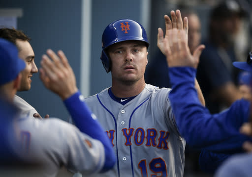 New York Mets' Jay Bruce celebrates with the dugout after running in a score off an RBI single by Jacob deGrom during the fifth inning of a baseball game against the Los Angeles Dodgers in Los Angeles, Monday, Sept. 3, 2018. (AP Photo/Kelvin Kuo)