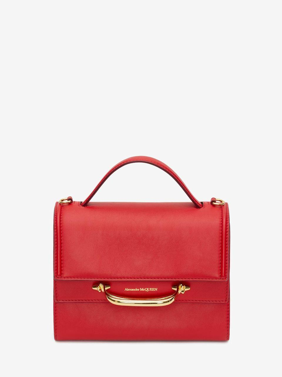 """<p><a class=""""link rapid-noclick-resp"""" href=""""https://go.redirectingat.com?id=127X1599956&url=https%3A%2F%2Fwww.alexandermcqueen.com%2Fen-gb%2Fthe-story%2Fthe-story-610021D78AT6080.html&sref=https%3A%2F%2Fwww.townandcountrymag.com%2Fuk%2Fstyle%2Fg35320192%2Fwhat-to-wear-for-an-at-home-lunar-new-year%2F"""" rel=""""nofollow noopener"""" target=""""_blank"""" data-ylk=""""slk:SHOP NOW"""">SHOP NOW</a></p><p>Alexander McQueen's iconic red story bag adds a sophisticated touch of red to celebrations.</p><p>Handbag, £1,650, Alexander McQueen.</p>"""