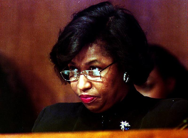 """<a href=""""http://www.senate.gov/artandhistory/history/common/briefing/women_senators.htm""""><strong>Served from:</strong></a> 1993-99 Carol Mosley Braun (D-Ill.), the first African-American woman U.S. senator, listens on Jan. 19, 1993 to Zoe Baird, U.S. President-elect Bill Clinton's nominee for U.S. Attorney General. (LUKE FRAZZA/AFP/Getty Images)"""