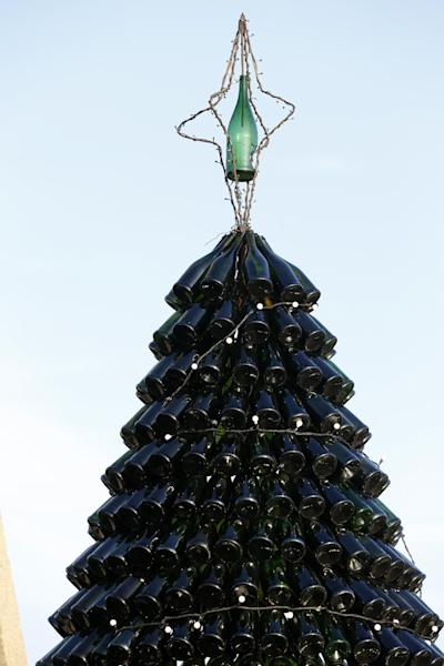 The Christmas tree made of bottles in Agariniu village, Lazdijai district, some 176 kilometers (110 miles) from Vilnius, Lithuania, Saturday, Dec. 28, 2013. Lithuanian policeman Dalius Valukonis says he spent three years and hundreds of hours of his free time to create the tree using bottles he got from local restaurants, bars, family and friends. (AP Photo/Mindaugas Kulbis)