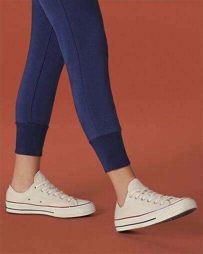 <p><span>Chuck Taylor All Star Optical White Low Tops</span> ($50)</p>