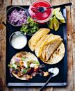 """Chicken and cauliflower get tossed in a garlicky chipotle marinade, charred beautifully, and nestled into tortillas with a creamy lime drizzle and some <a href=""""https://www.epicurious.com/recipes/food/views/quick-pickled-onions-395938?mbid=synd_yahoo_rss"""" rel=""""nofollow noopener"""" target=""""_blank"""" data-ylk=""""slk:pickled red onions"""" class=""""link rapid-noclick-resp"""">pickled red onions</a>. <a href=""""https://www.epicurious.com/recipes/food/views/chipotle-chicken-and-cauliflower-tacos?mbid=synd_yahoo_rss"""" rel=""""nofollow noopener"""" target=""""_blank"""" data-ylk=""""slk:See recipe."""" class=""""link rapid-noclick-resp"""">See recipe.</a>"""