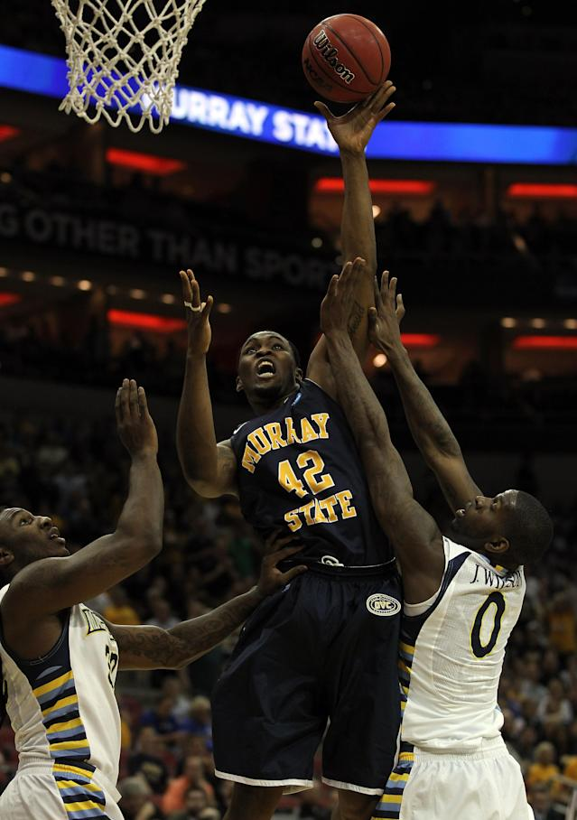 LOUISVILLE, KY - MARCH 17: Ivan Aska #42 of the Murray State Racers shoots over Jae Crowder #32 and Jamil Wilson #0 of the Marquette Golden Eagles in the first half during the third round of the 2012 NCAA Men's Basketball Tournament at KFC YUM! Center on March 15, 2012 in Louisville, Kentucky. (Photo by Jonathan Daniel/Getty Images)