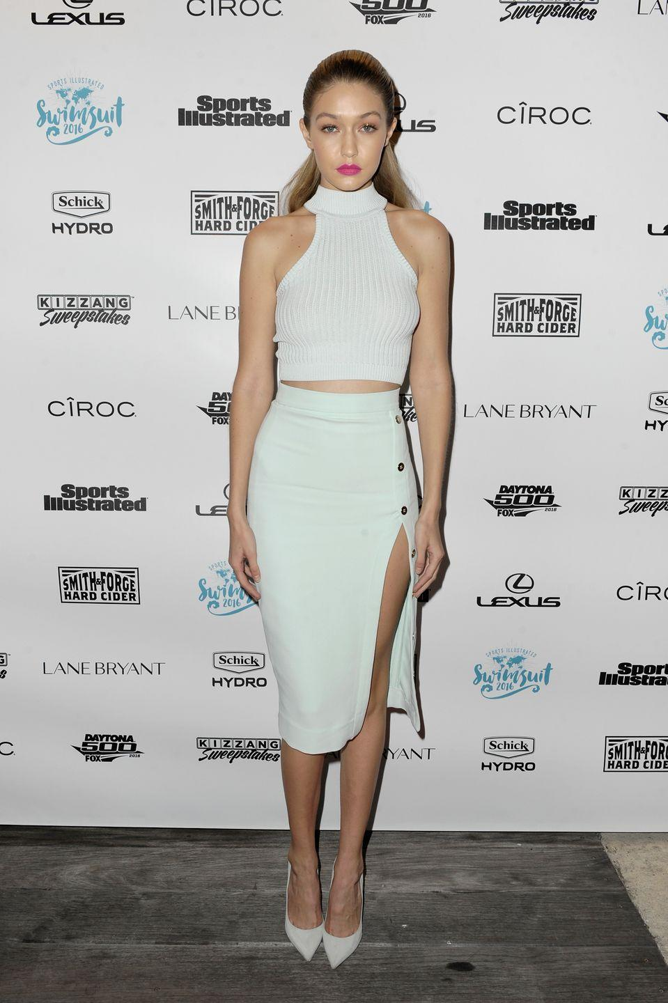 <p>Donning all white, Hadid wore a crop top, high-slit pencil skirt and matching pumps for <em>Sports Illustrated</em>'s A Night at Sea VIP Boat Cruise in Miami. </p>