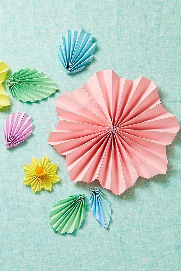 """<p>Colorful accordion-folded paper can take the shape of flowers, making them perfect for sprucing up your Easter table or even a drab wall. </p><p><em><a href=""""https://www.goodhousekeeping.com/holidays/easter-ideas/g2217/easter-decorations/?slide=5"""" rel=""""nofollow noopener"""" target=""""_blank"""" data-ylk=""""slk:Get the tutorial »"""" class=""""link rapid-noclick-resp"""">Get the tutorial »</a> </em></p>"""