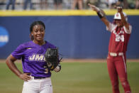 CORRECTS TO FIFTH INNING NOT SECOND INNING - James Madison starting pitcher Odicci Alexander (3) stands in the pitching circle as Oklahoma's Jayda Coleman (24) celebrates at second base behind her after hitting a double in the fifth inning of an NCAA Women's College World Series softball game Monday, June 7, 2021, in Oklahoma City. (AP Photo/Sue Ogrocki)