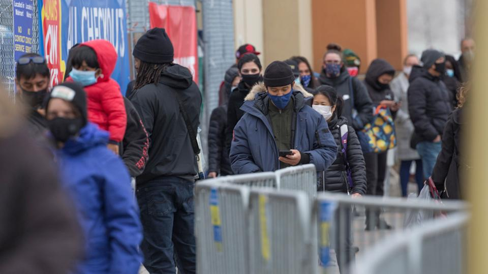 Shoppers line up outside a Scarborough, Ont., Walmart Superstore in this undated file photo. Ontario is defending its new rules designed to lower COVID-19 transmission amid criticism from some businesses. (Photo: Rick Madonik via Getty Images)