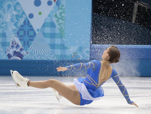Andrea Davidovich falls as she and Evgeni Krasnopolski of Israel compete in the pairs free skate figure skating competition at the Iceberg Skating Palace during the 2014 Winter Olympics, Wednesday, Feb. 12, 2014, in Sochi, Russia. (AP Photo/Ivan Sekretarev)