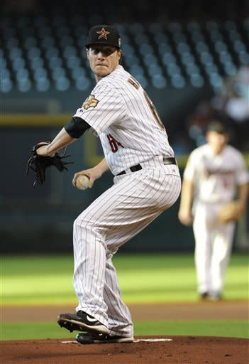 Houston Astros' Lucas Harrell delivers a pitch against the San Diego Padres in the first inning of a baseball game Wednesday, June 27, 2012, in Houston. (AP Photo/Pat Sullivan)