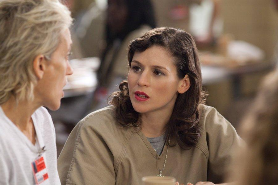 Yael Stone in costume as prison inmate Lorna Morello on Orange Is The New Black