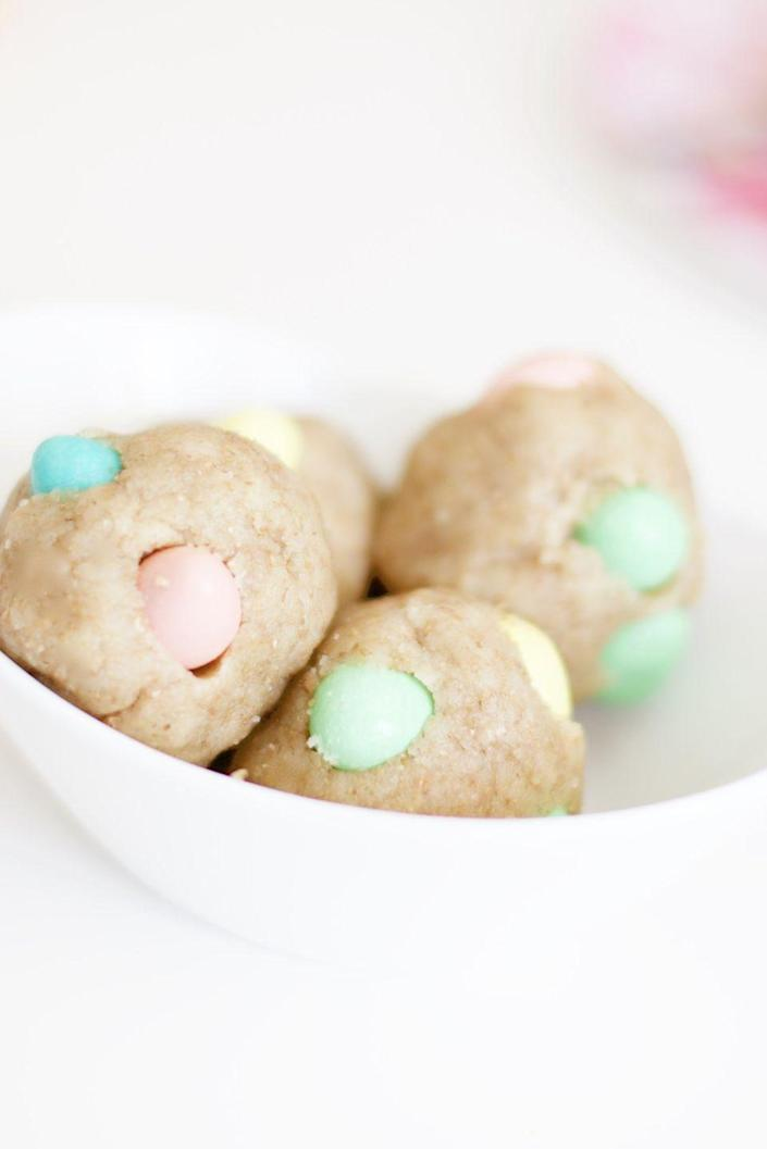 """<p>While your ham roasts in the oven, prepare these cookie dough balls and pop them in the fridge. </p><p><em><a href=""""http://northsouthblonde.com/cadbury-mini-egg-balls/"""" rel=""""nofollow noopener"""" target=""""_blank"""" data-ylk=""""slk:Get the recipe from North South Blonde »"""" class=""""link rapid-noclick-resp"""">Get the recipe from North South Blonde »</a></em> </p>"""