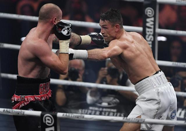 Callum Smith (R) used his height to his advantage against his more experienced opponent George Groves (L) (AFP Photo/AMER HILABI)
