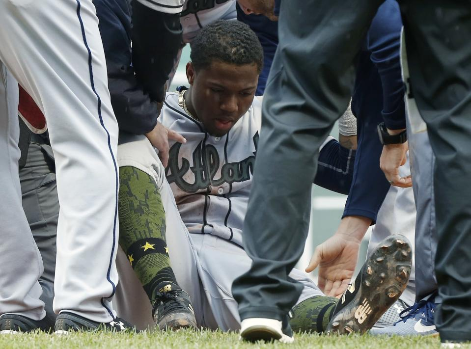 Braves star Ronald Acuña Jr. limped off the field after suffering a knee injury against the Boston Red Sox. (AP Photo)
