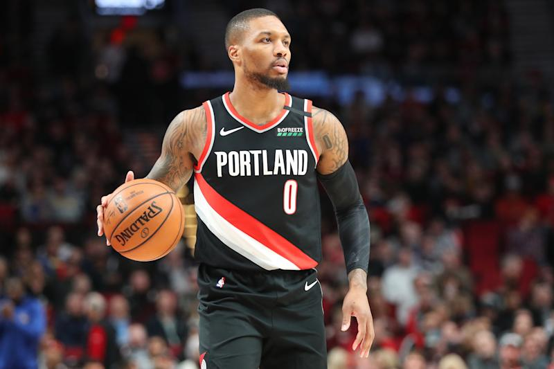 PORTLAND, OREGON - JANUARY 20: Damian Lillard #0 of the Portland Trail Blazers dribbles against the Golden State Warriors in the first quarter during their game at Moda Center on January 20, 2020 in Portland, Oregon. NOTE TO USER: User expressly acknowledges and agrees that, by downloading and or using this photograph, User is consenting to the terms and conditions of the Getty Images License Agreement (Photo by Abbie Parr/Getty Images) (Photo by Abbie Parr/Getty Images)