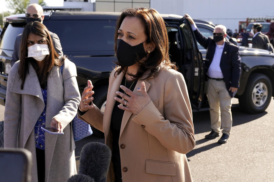 Democratic vice presidential candidate Sen. Kamala Harris, D-Calif., speaks to the media after arriving at Sky Harbor International Airport, Wednesday, Oct. 28, 2020, in Phoenix. (AP Photo/Matt York)