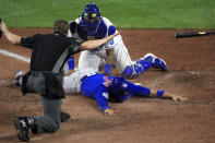 Chicago Cubs catcher Victor Caratini (7) is called safe by home plate umpire Alex Tosi, during the ninth inning of a baseball game at Kauffman Stadium in Kansas City, Mo., Wednesday, Aug. 5, 2020. Kansas City Royals catcher Salvador Perez, top, was late with the tag. The Cubs defeated the Royals 6-1. (AP Photo/Orlin Wagner)