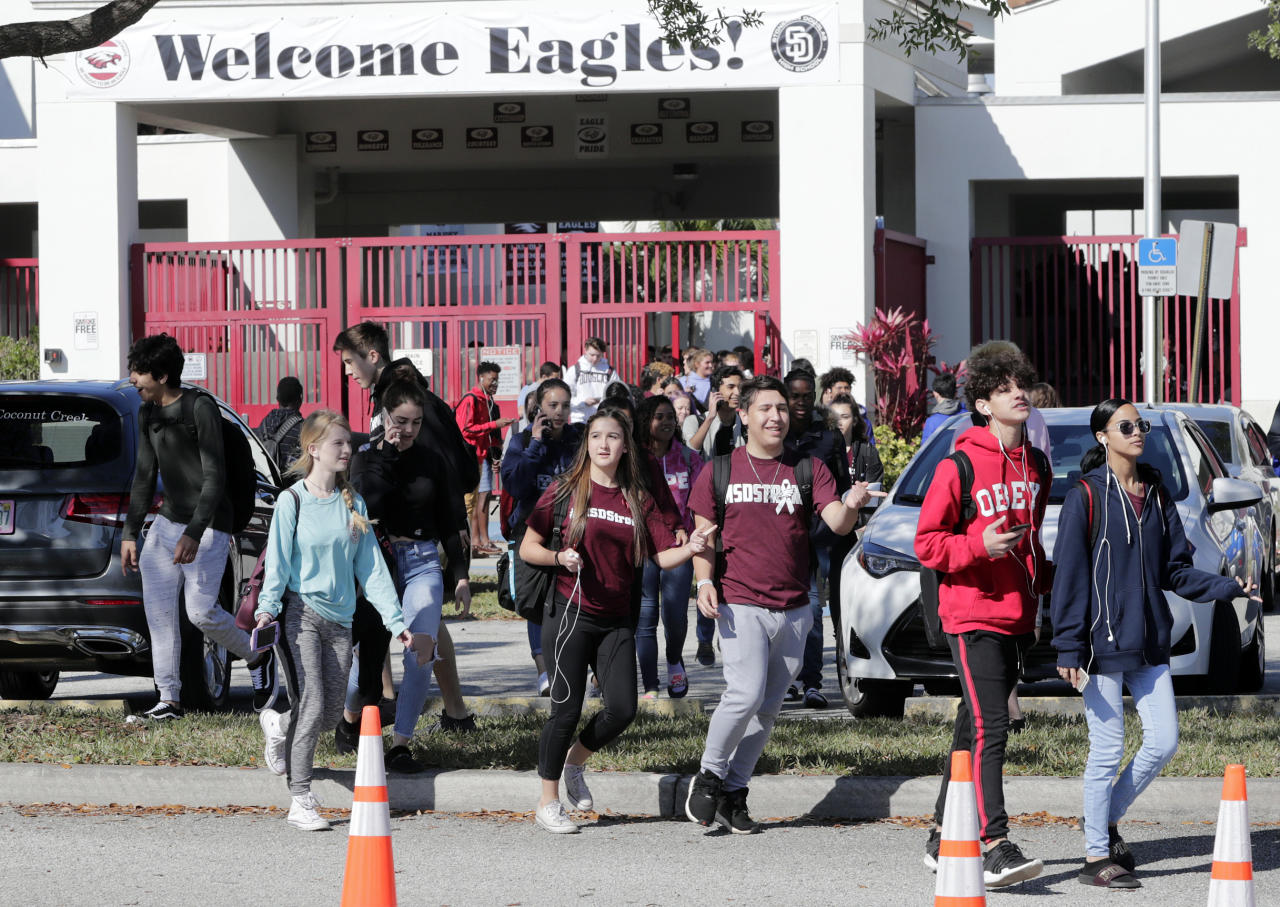 <p>Students walk out of Marjory Stoneman Douglas High School, as part of a nationwide protest against gun violence, Wednesday, March 14, 2018, in Parkland, Fla. Organizers say nearly 3,000 walkouts are set in the biggest demonstration yet of the student activism that has emerged following the massacre of 17 people at Marjory Stoneman Douglas High School in February. (Photo: Lynne Sladky/AP) </p>