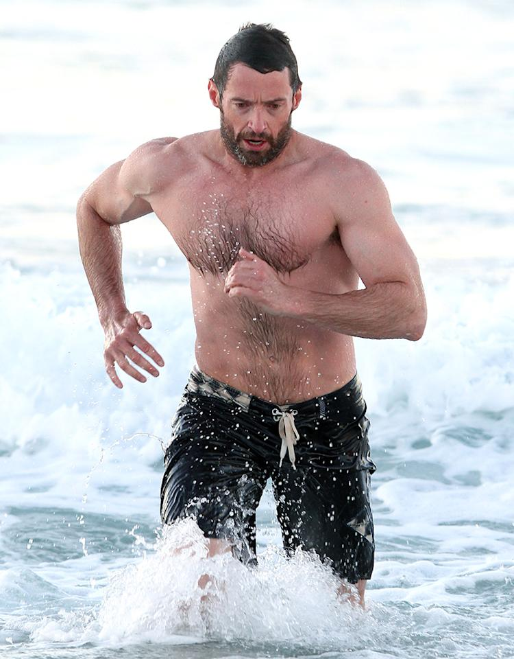 Muscular Hugh Jackman shirtless in Bondi, Sydney.