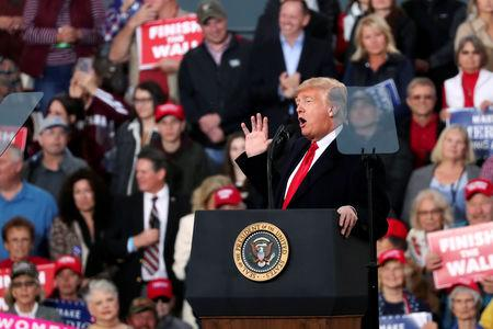 FILE PHOTO: U.S. President Trump rallies with supporters in a hangar at Missoula International Airport in Missoula, Montana