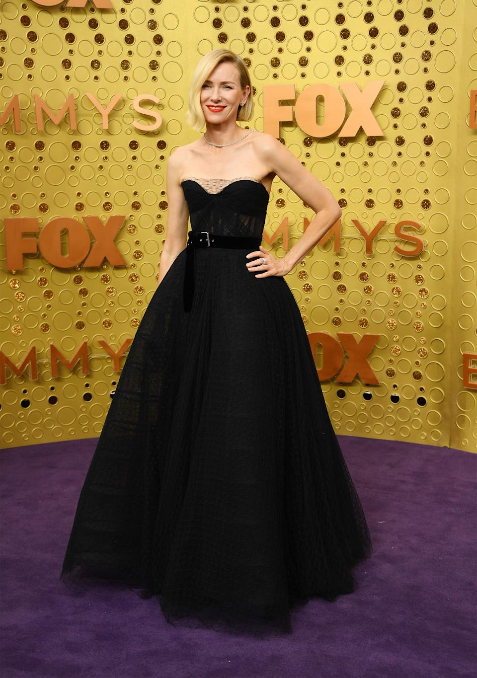 Watts brought the glamour to the Emmy purple carpet in a belted black gown by Dior and sleek asymmetrical blond bob. [Photo: Getty]