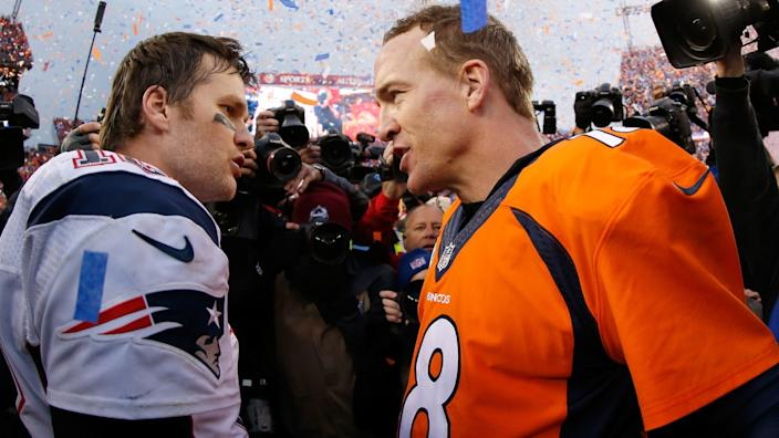 Peyton Manning, right, talks to Tom Brady after helping the Denver Broncos beat the New England Patriots.
