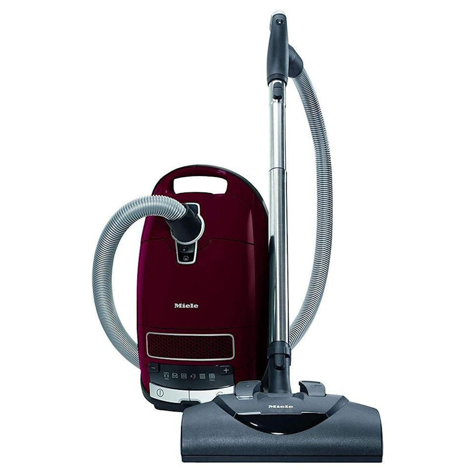 """<p><strong>Miele</strong></p><p>amazon.com</p><p><strong>$929.00</strong></p><p><a href=""""https://www.amazon.com/dp/B01I6CU2F6?tag=syn-yahoo-20&ascsubtag=%5Bartid%7C10055.g.1833%5Bsrc%7Cyahoo-us"""" rel=""""nofollow noopener"""" target=""""_blank"""" data-ylk=""""slk:Shop Now"""" class=""""link rapid-noclick-resp"""">Shop Now</a></p><p>This Miele earned our <a href=""""https://www.goodhousekeeping.com/institute/about-the-institute/a22148/about-good-housekeeping-seal/"""" rel=""""nofollow noopener"""" target=""""_blank"""" data-ylk=""""slk:Good Housekeeping Seal"""" class=""""link rapid-noclick-resp"""">Good Housekeeping Seal</a> for its ability to effectively clean every type of flooring. It's equipped with <strong>a telescoping wand, dusting brush, upholstery tool and a crevice tool to tackle upholstery, stairs, lamps shades, ceiling moldings and more. </strong></p><p>Even hard-to-clean plush carpets are no match for the power nozzle and brush roll that adjust to five different levels to make easy work of powering through dense pile to lift dirt, dust, and pet hair. Allergy sufferers will love the high filtration bag and HEPA AirClean filter that prevent dust from being released back into the air. In Good Housekeeping tests, Miele vacuums do the best job of picking up and trapping dust and dirt. </p>"""