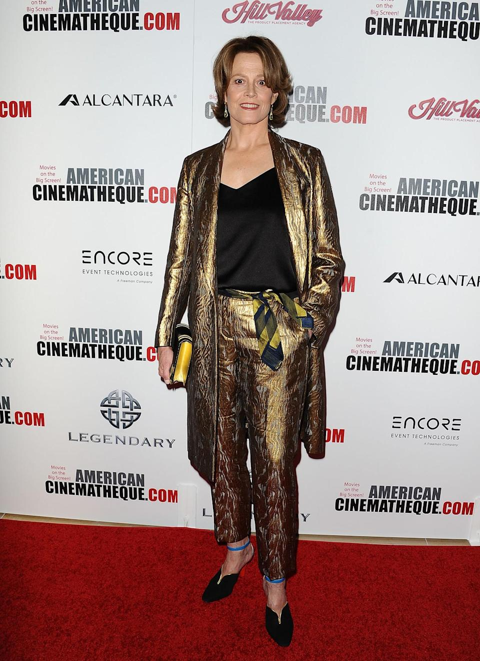 <p>Add an edge to your trouser suit vibe with a metallic jacket and matching trousers – perfect for party season. [Photo: Getty] </p>