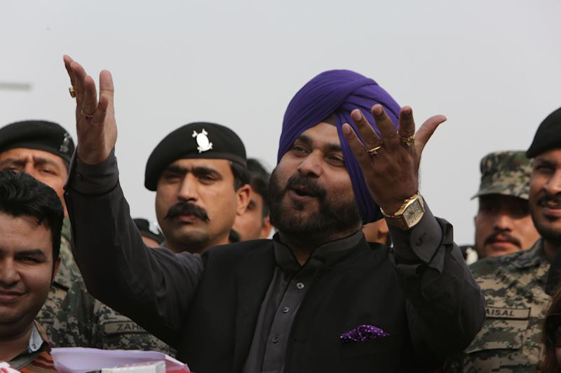 Former Indian cricketer-turned-politician Navjot Singh Sidhu arrives at Pakistani border post Wagha near Lahore, Pakistan, Tuesday, Nov. 27, 2018. Sidhu led his country's delegation to Pakistan for the groundbreaking ceremony of Kartarpur corridor on Wednesday, to give access to Indian Sikh pilgrims to visit the shrine of their spiritual leader Guru Nanak Dev in Pakistan. (AP Photo/K.M. Chaudary)