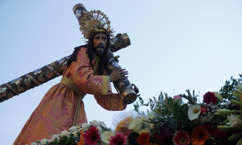 An image of Jesus Christ is carried by devotees taking part in the Jesus of Nazareth Merced procession during Holy Week in Guatemala City
