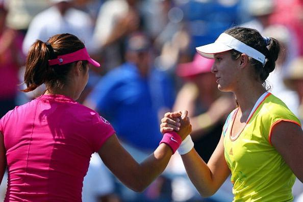 Li Na and Laura Robson after their US Open encounter last year, which Robson won