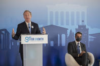 Microsoft President Brad Smith, left, speaks next to Greek Prime Minister Kyriakos Mitsotakis during a ceremony held in the Acropolis Museum, central Athens, on Monday, Oct. 5, 2020. Microsoft has announced plans to build three data centers in greater Athens, providing a badly needed investment of up to $1 billion to the Greek economy which has been hammered by the pandemic. (AP Photo/Petros Giannakouris)